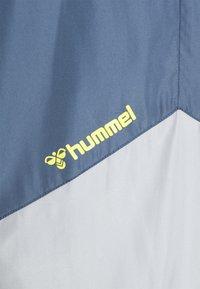 Hummel - HMLSULLIVAN PANTS - Tracksuit bottoms - china blue - 2