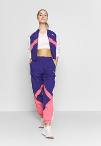 Puma - STUDIO CLASH ACTIVE TRACK JACKET - Treningsjakke - purple - 1