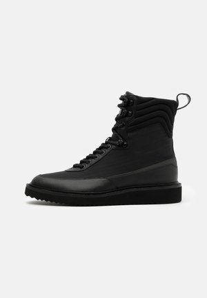 DISTRICT - Lace-up ankle boots - black