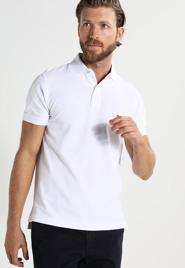 PERFORMANCE SLIM FIT - Koszulka polo - white
