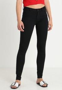 Vero Moda - VMJULIA FLEX IT MR SLIM JEGGING GU1 - Jeans Skinny Fit - black - 0