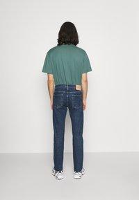 Edwin - TAPERED - Straight leg jeans - blue denim - 2