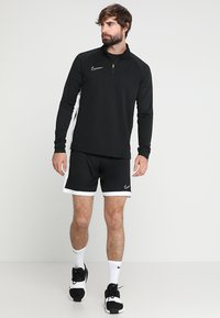 Nike Performance - DRY  - T-shirt sportiva - black/white - 1