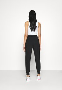 ONLY - ONLPOPTRASH EASY RELAX PANT - Tracksuit bottoms - black - 2