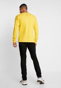Edwin - SLIM TAPERED - Slim fit jeans - rinsed kaihara black - 2