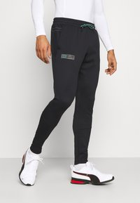 Under Armour - STORM PANTS - Tracksuit bottoms - black - 0
