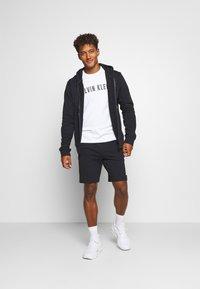 Calvin Klein Performance - SHORT - Sports shorts - black - 1
