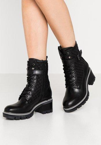 Kovbojské/motorkářské boty