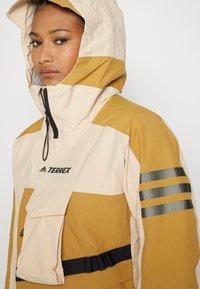 adidas Performance - TERREX XPLORIC RAIN - Hardshell jacket - halo blush/mesa - 7
