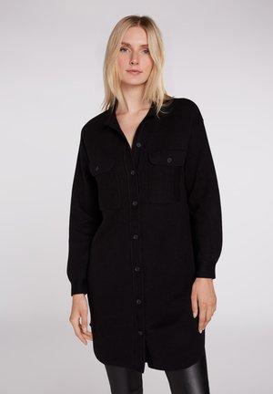 SHAKET IN VERLÄNGERTER FORM - Button-down blouse - black