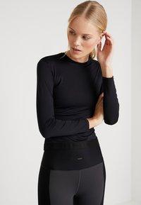 Daquïni - T-shirt à manches longues - black - 0