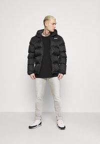 Replay - ANBASS XLITE - Slim fit jeans - medium grey - 1