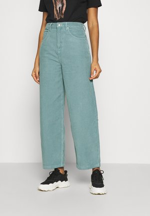 TEA BAGGY - Trousers - teal