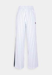 Fila - HALA TRACK PANTS - Trousers - blanc de blanc/black iris - 4
