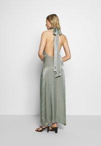 UNIQUE 21 - HALTERNECK OPEN BACK DRESS - Společenské šaty - green - 2