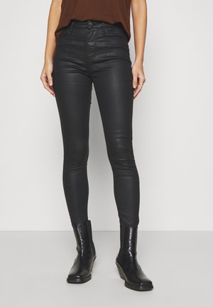 SOFT SKINNY COATED - Trousers - black