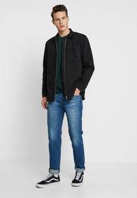 Levi's® - 511™ SLIM FIT - Jeans slim fit - overt adapt - 1