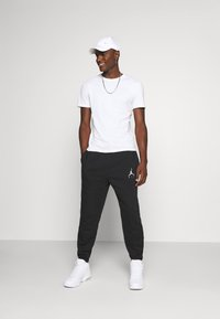 Jordan - Pantalon de survêtement - black/white - 1
