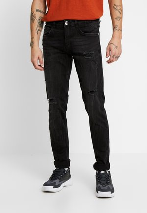 STOCKHOLM DESTROY - Slim fit jeans - panther black