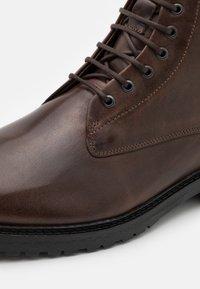 Royal RepubliQ - ALIAS CITY HIKER LACE UP BOOT - Lace-up ankle boots - brown - 5