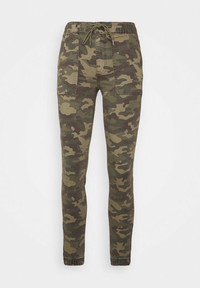 HI-RISE JEGGING JOGGER - Pantalon de survêtement - green