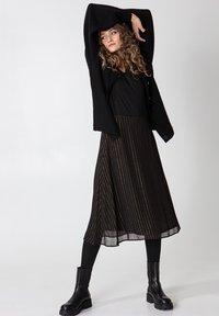 Indiska - ROS LUREX - A-line skirt - black - 3