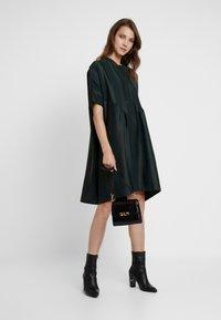 Selected Femme - SLFVIOLA OVERSIZE DRESS - Shirt dress - scarab - 2