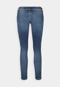 Diesel - SLANDY-LOW-ZIP - Jeans Skinny Fit - light blue - 1