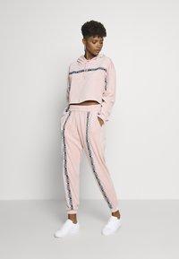 adidas Originals - CUFFED PANTS - Spodnie treningowe - pink spirit - 1