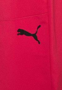 Puma - TRAIN TECH PANT - Tracksuit bottoms - american beauty - 4