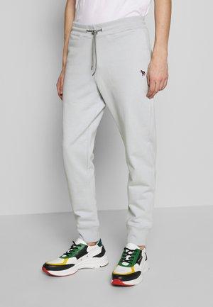 PANTS - Teplákové kalhoty - light blue