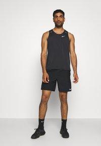 Nike Performance - RISE TANK - Sports shirt - black - 1