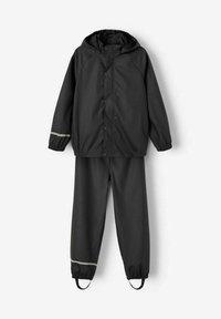 Name it - NKNDRY RAIN SET UNISEX - Rain trousers - black - 2