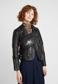 Calvin Klein Jeans - COATED ROUND STREET PACK - Bum bag - black - 5