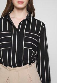 ONLY - ONLFREYA  - Button-down blouse - black/cloud dancer - 6
