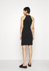 Puma - BODYCON DRESS - Shift dress - black - 2