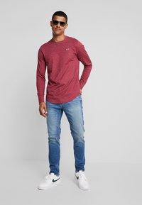 Hollister Co. - Slim fit jeans - bright medium - 1