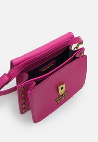 Versace Jeans Couture - CHARMS CROSSBODY - Across body bag - fuxia - 3