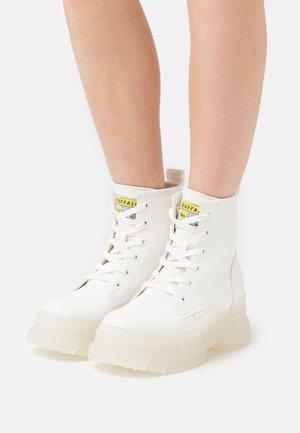 VEGAN ASPHA - Platform ankle boots - white