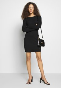 Even&Odd Petite - DRESS BODYON SOLID - Vestito di maglina - black - 1