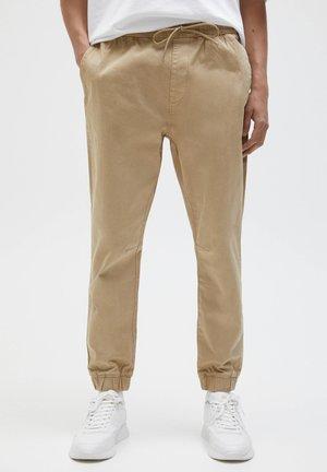 Teplákové kalhoty - mottled beige