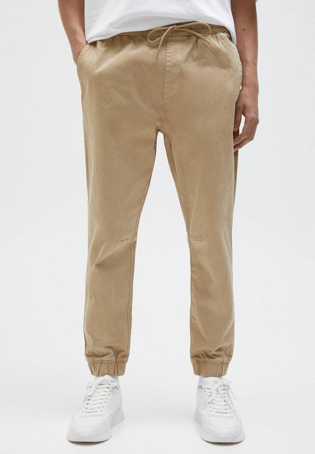 Pantaloni sportivi - mottled beige