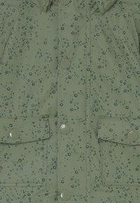 MINI A TURE - JULIEN UNISEX - Waterproof jacket - oil green - 3