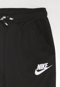 Nike Sportswear - TAPERED PANT - Trainingsbroek - black/whte - 2