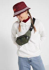 adidas Originals - CAMO WAISTBAG - Bum bag - green - 6