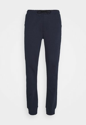DISCUS - Tracksuit bottoms - navy