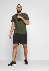 Nike Performance - DRY TEE CREW SOLID - Basic T-shirt - khaki - 1