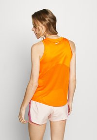 Nike Performance - MILER TANK - Sports shirt - magma orange/reflective silver