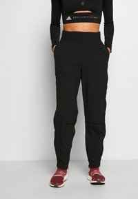 adidas by Stella McCartney - Outdoor trousers - black - 0