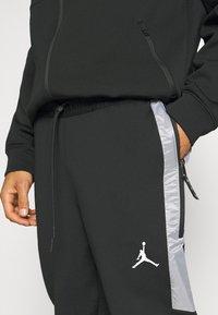 Jordan - AIR PANT - Tracksuit bottoms - black/white - 4